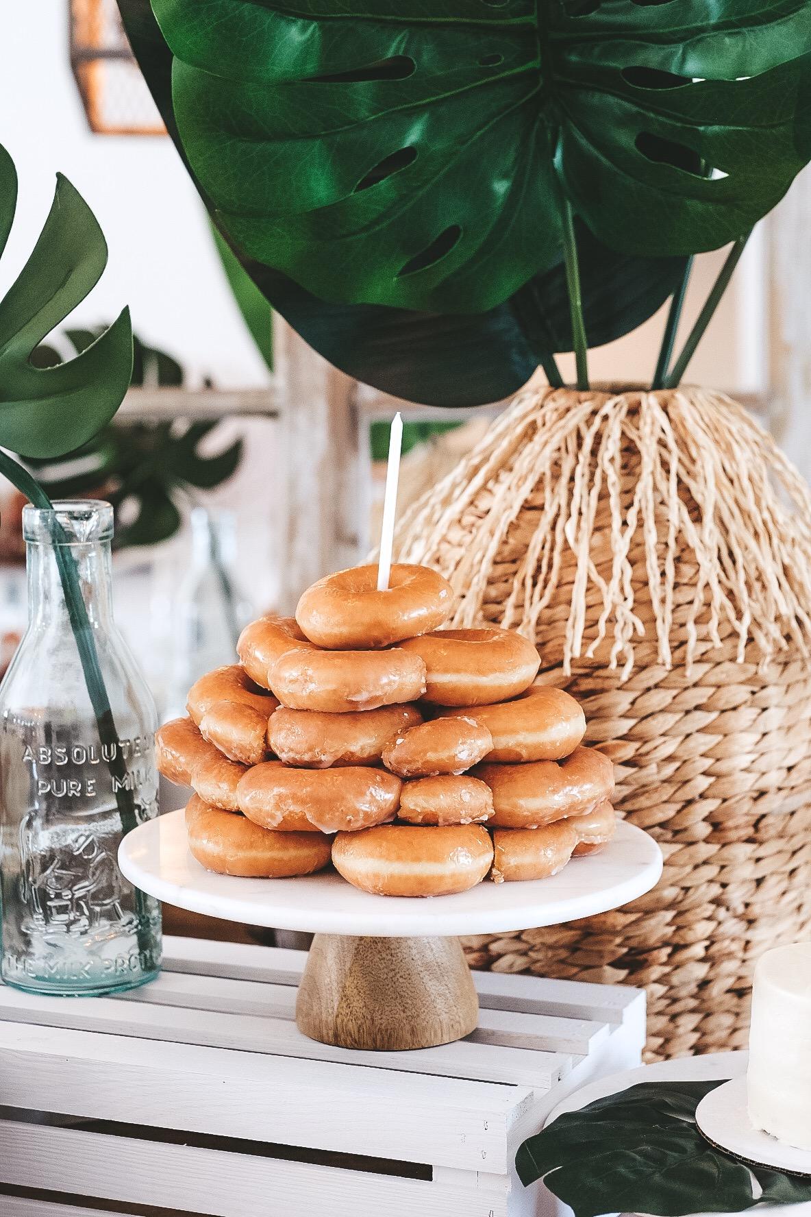 Modern surfer theme first birthday party.  Black and white boy birthday decor.  Krispy Kreme donut cake.