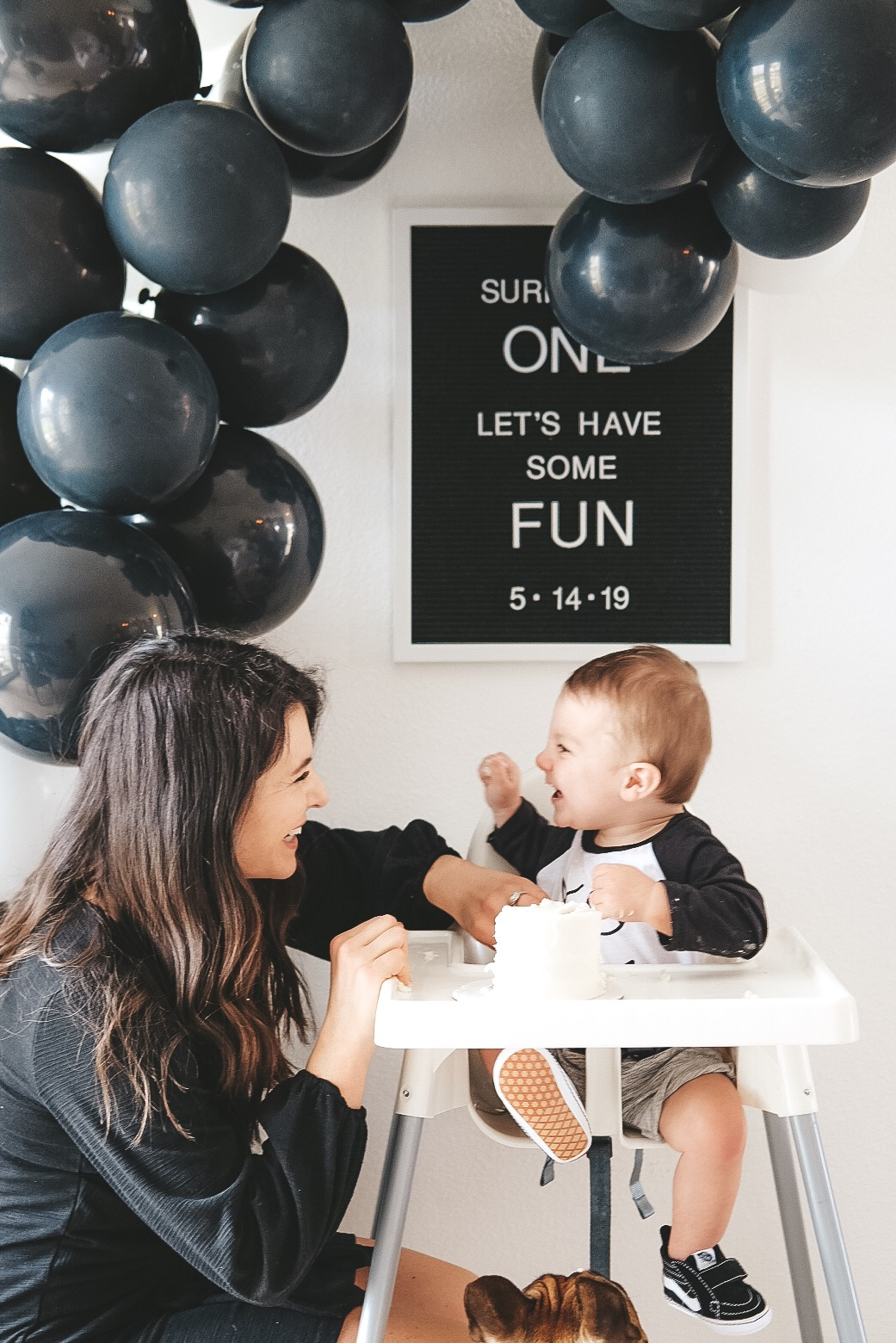 Modern surfer theme birthday party.  Black and white birthday party.  Baby boy frist birthday party. Black and white balloon arch. Simple white smash cake.