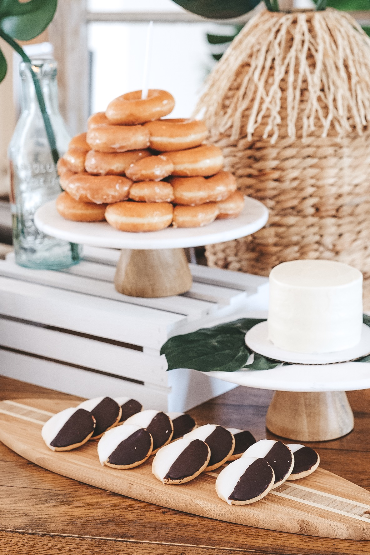 Modern surfer theme first birthday party.  Black and white boy birthday decor.  Krispy Kreme donut cake. Black and white cookies.