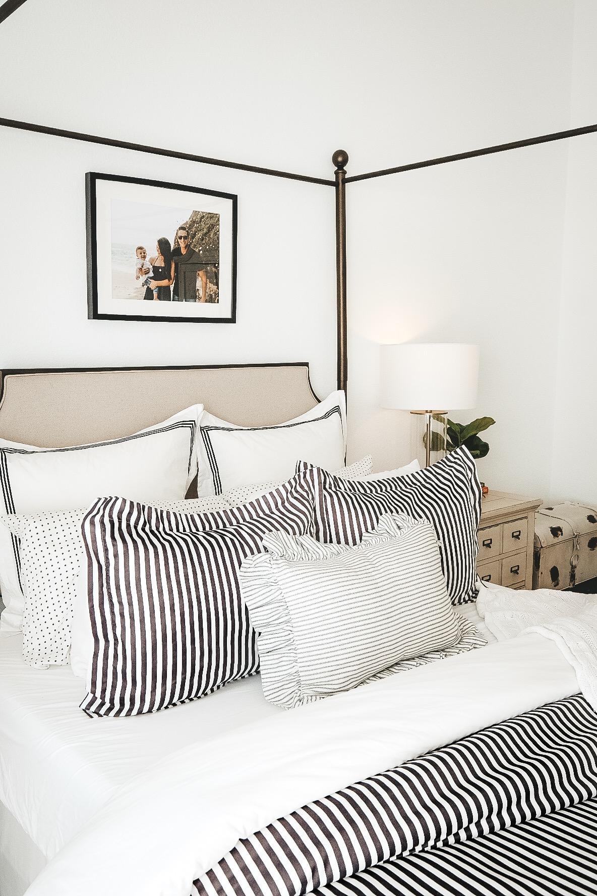 Modern Transitional Bedrrom Decor.  Black and White Master Bedroom.  Canopy Bed in Antique Brass. Light wash LVP flooring.