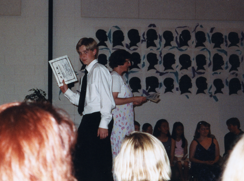 That's me walking across the stage at my 6th Grade Graduation... The peak of my academic achievement.