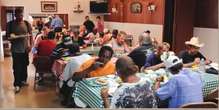 Sacred Heart Church St Vincent De Paul Society  volunteers twice a year at the Kennedy Soup Kitchen in Reading. They buy the food & supplies, prepare and serve the meals, and clean up the equipment & rooms.