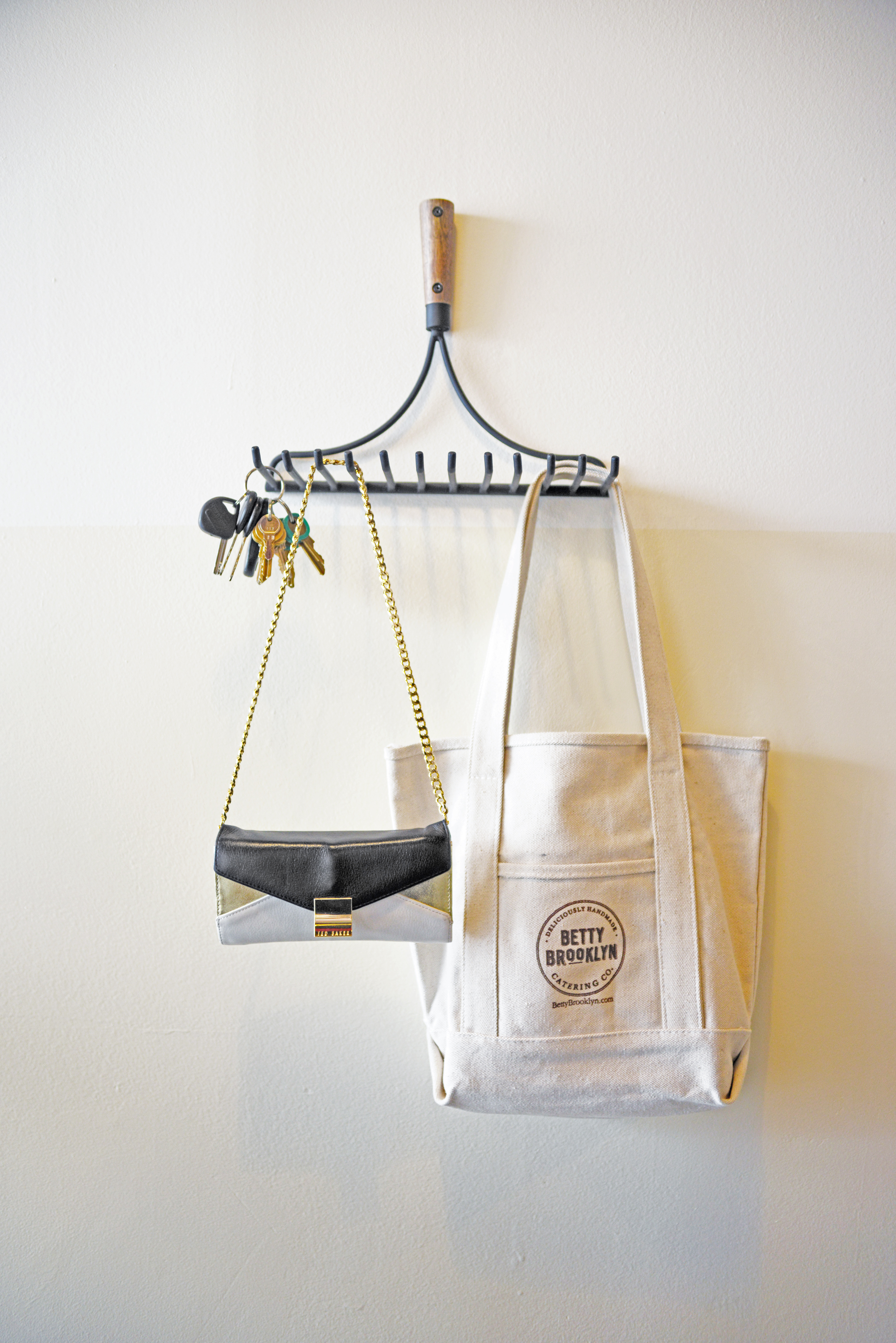 Kalin sourced this pitchfork style hanger to hold her keys and accessories in the office. It's functional, slightly humorous and works with the overall design of the space  | Betty Brooklyn Catering Co. | Photography by: Lauren L Caron © 2015.