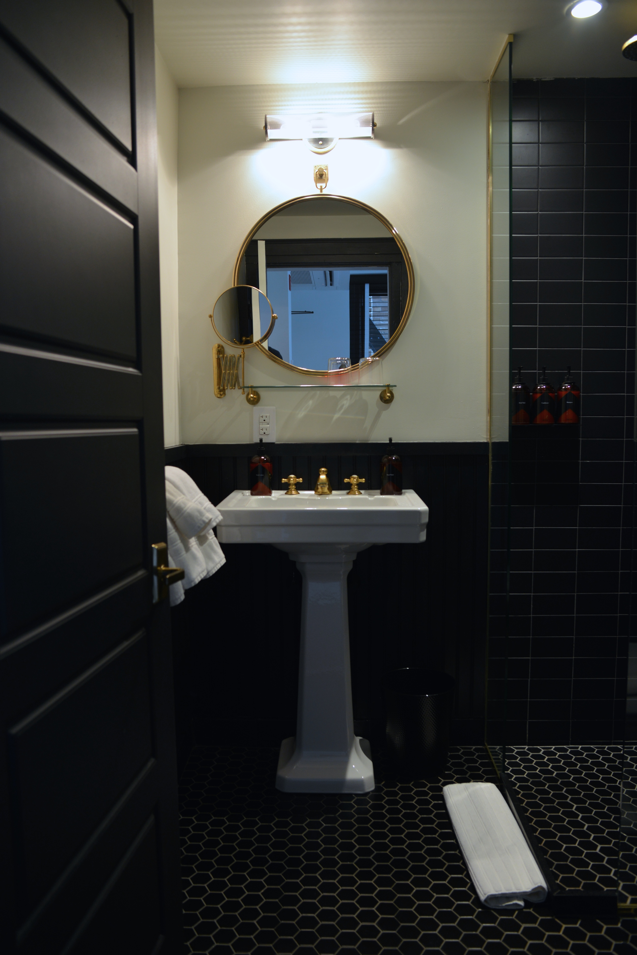 The Bathrooms are all predominantly black - Photograph by Lauren L Caron | The Dean Hotel