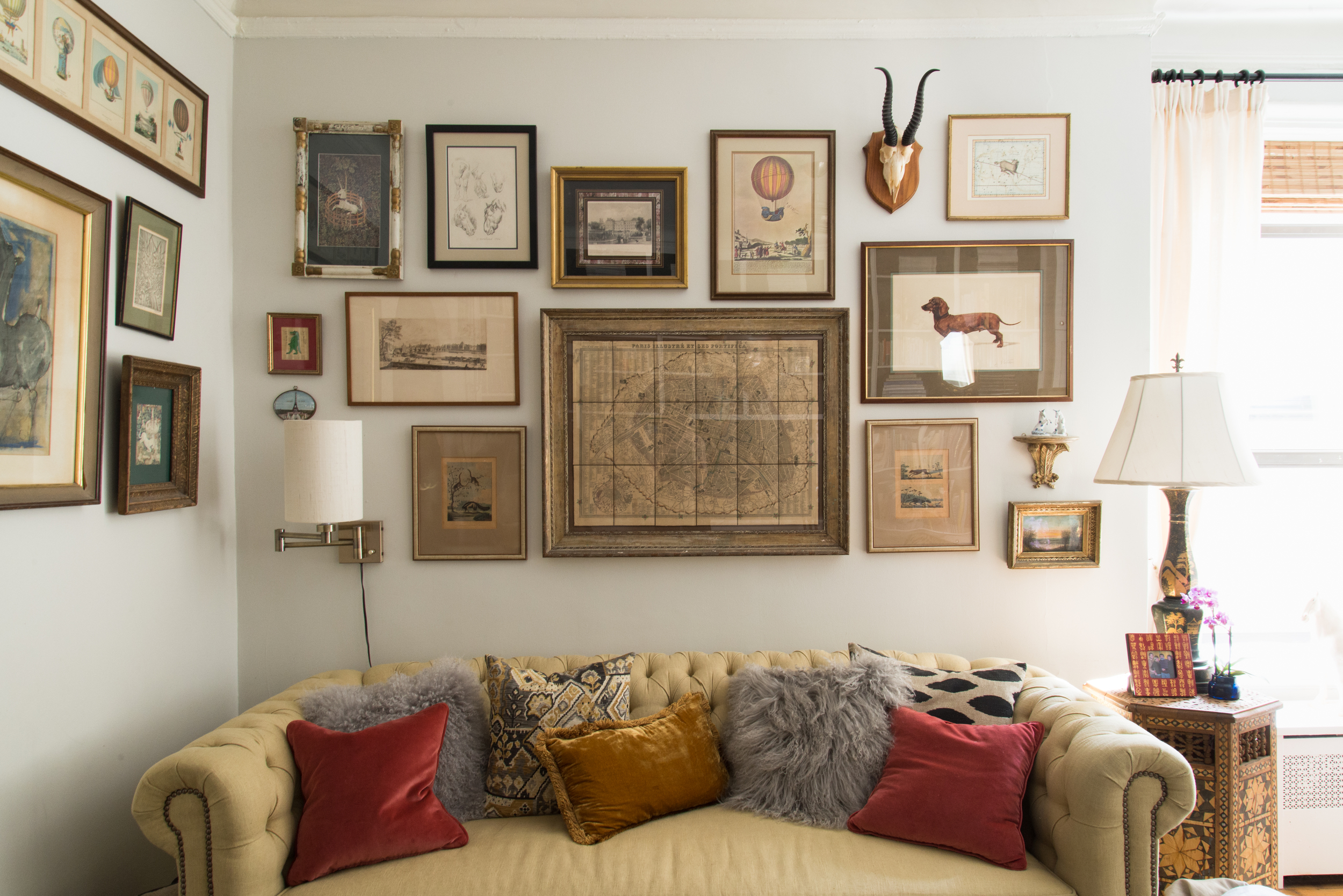 my favorite gallery wall in the home that holds my favorite prints / that sofa doubles as a guest bed.