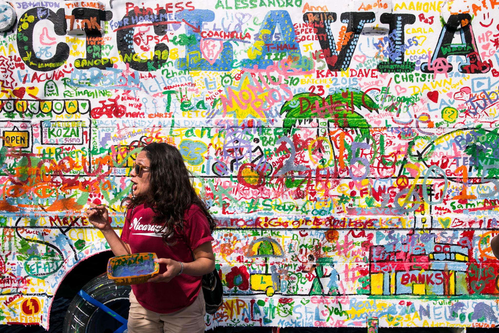 Rest your legs and get creative with the community mural