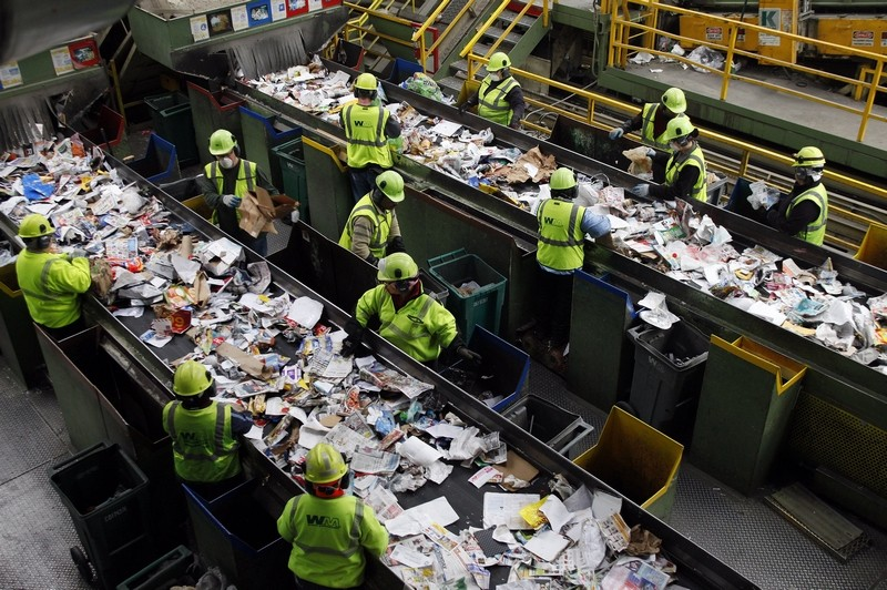 Workers sorting recycling at a recycling center