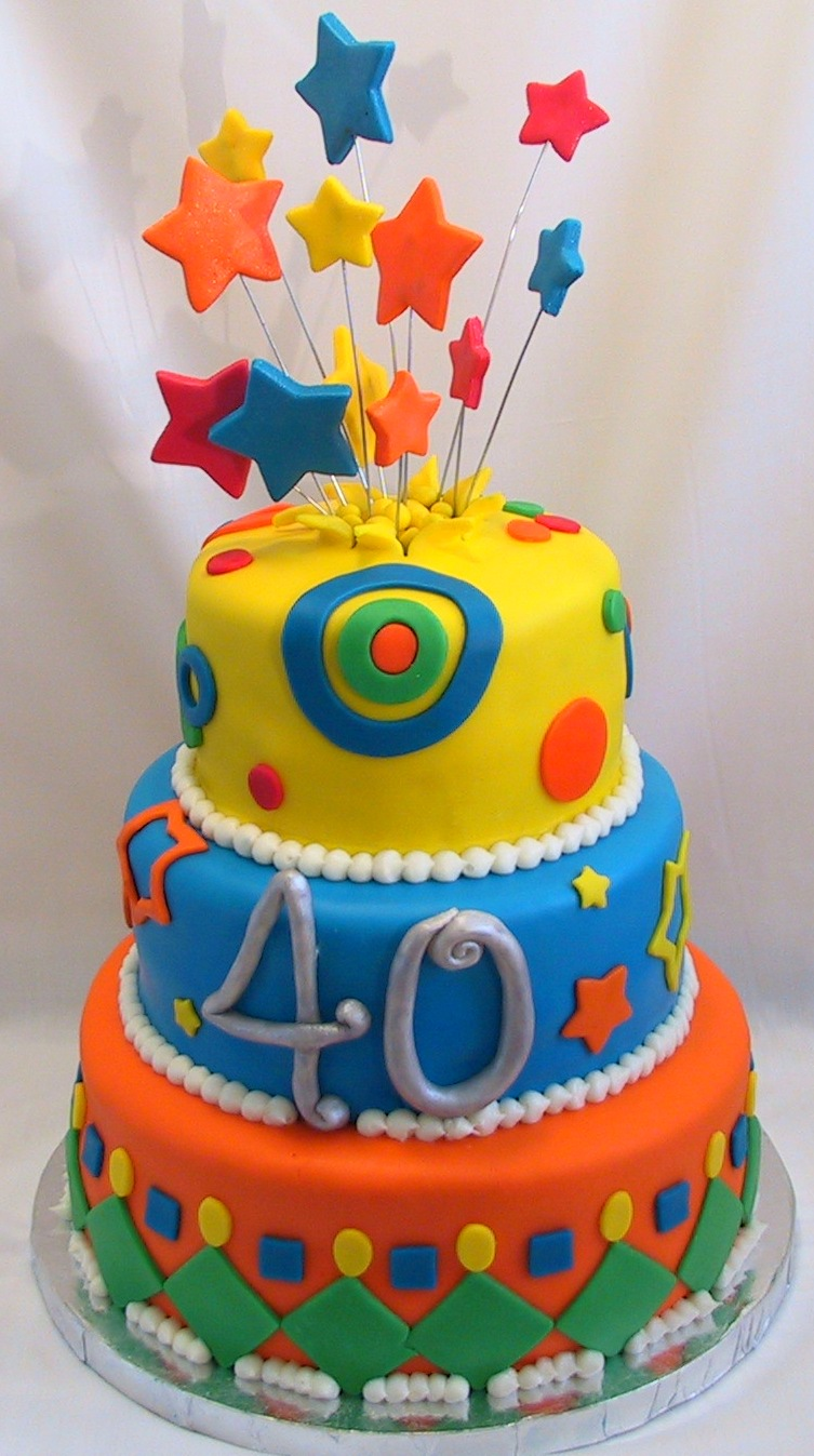 birthday-cakes-charming-yellow-blue-orange-fondant-cake-decorating-idea-with-colorful-stars-wondrous-fondant-cake-decorating-ideas.jpg