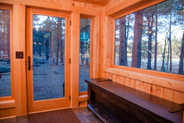 Mudroom: Custom oversized bench housing boot warmers.