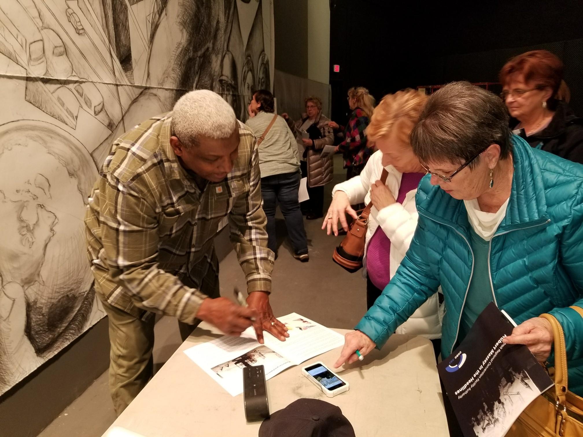 Hubert Massey signing autographs