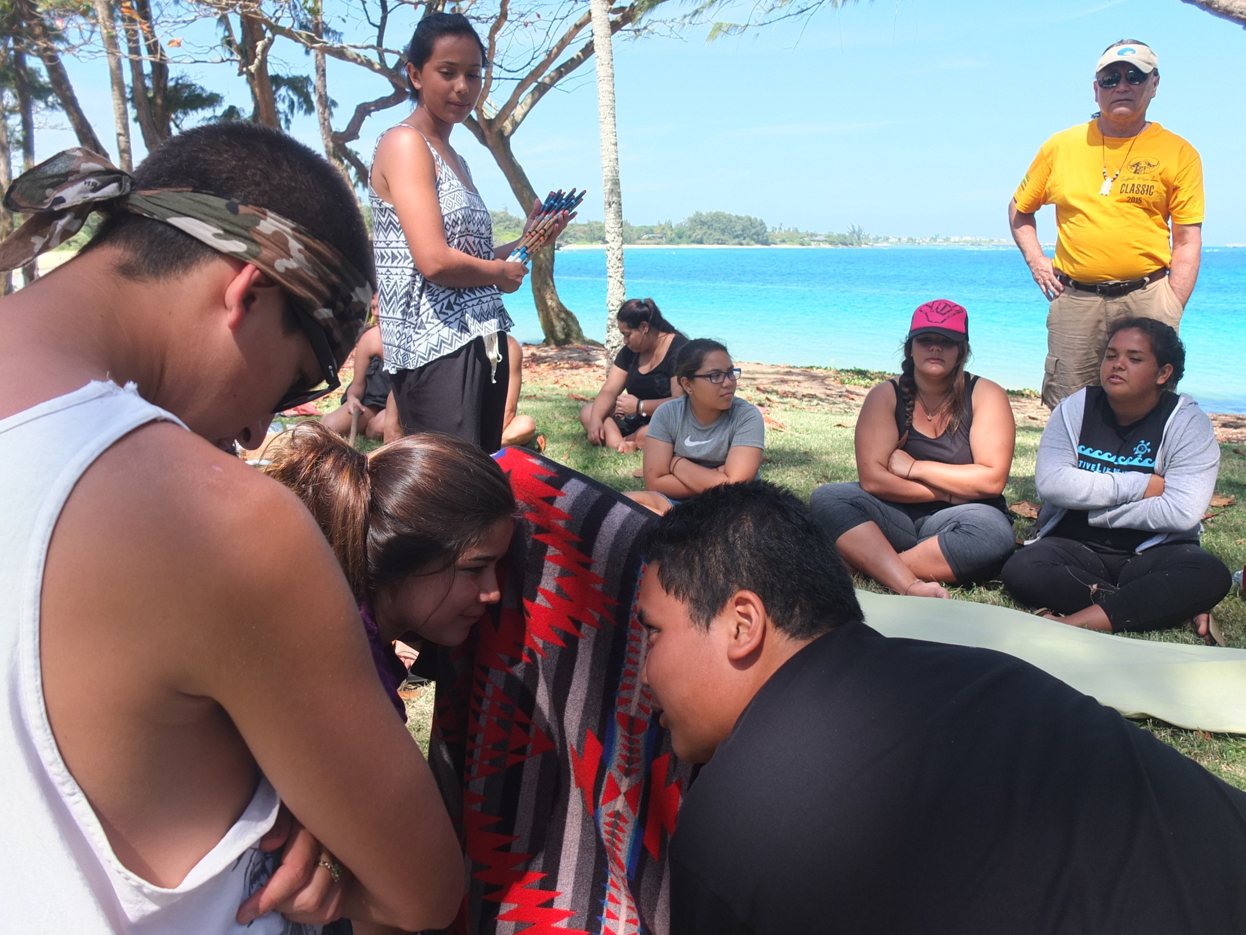 """Southern California Youth share traditional Games with Na kama kai. """"Peon"""" is a traditional gambling game which takes skill, intuition and strategy. Normally played at night around campfire and accompanied by song. Traditional Gaming Curriculum Courtesy of Sycuan Institute of Tribal Gaming (SITG) at San Diego State U."""
