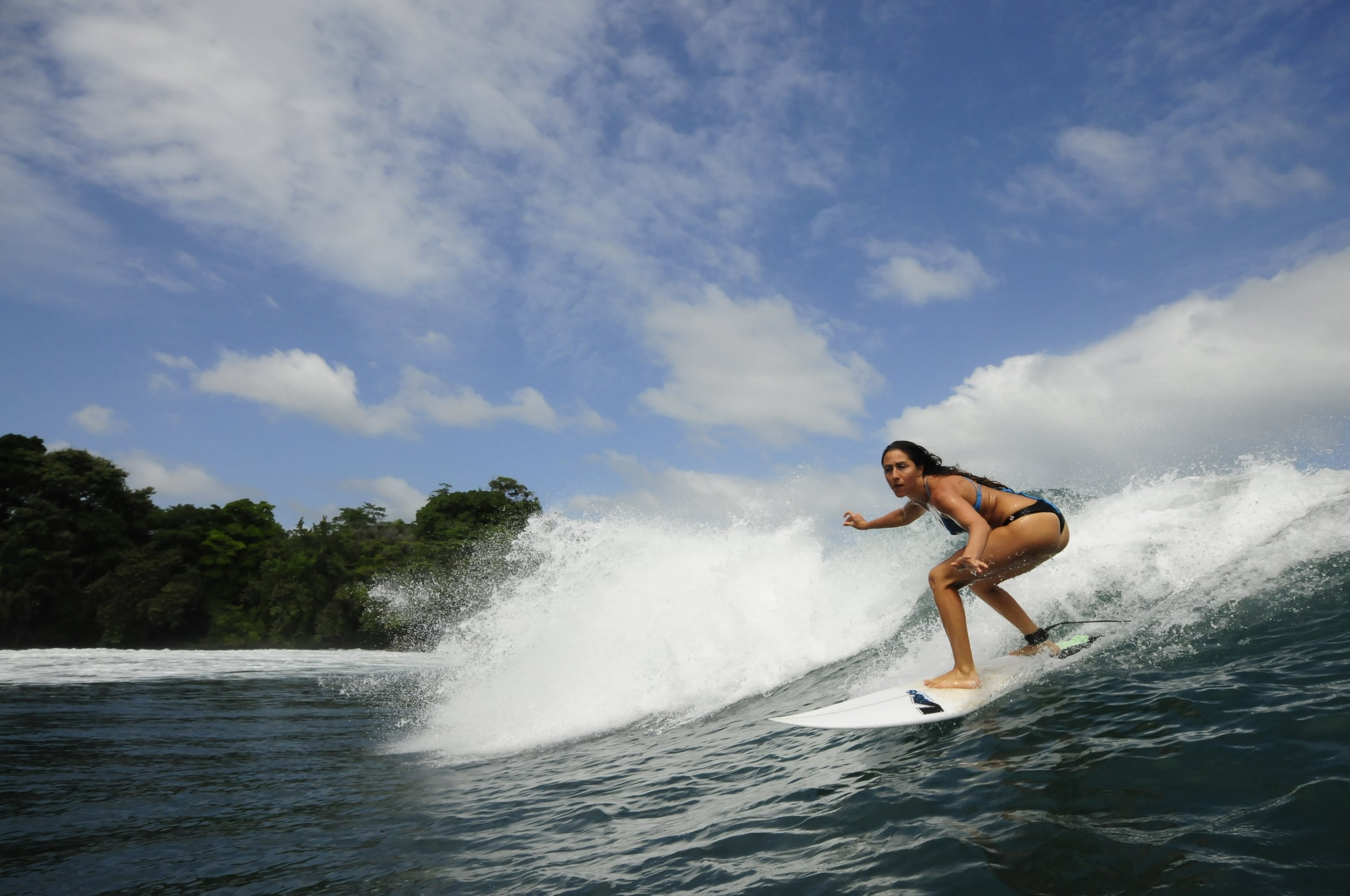 Host and Leader, Tara Ruttenberg sliding along in Central America.
