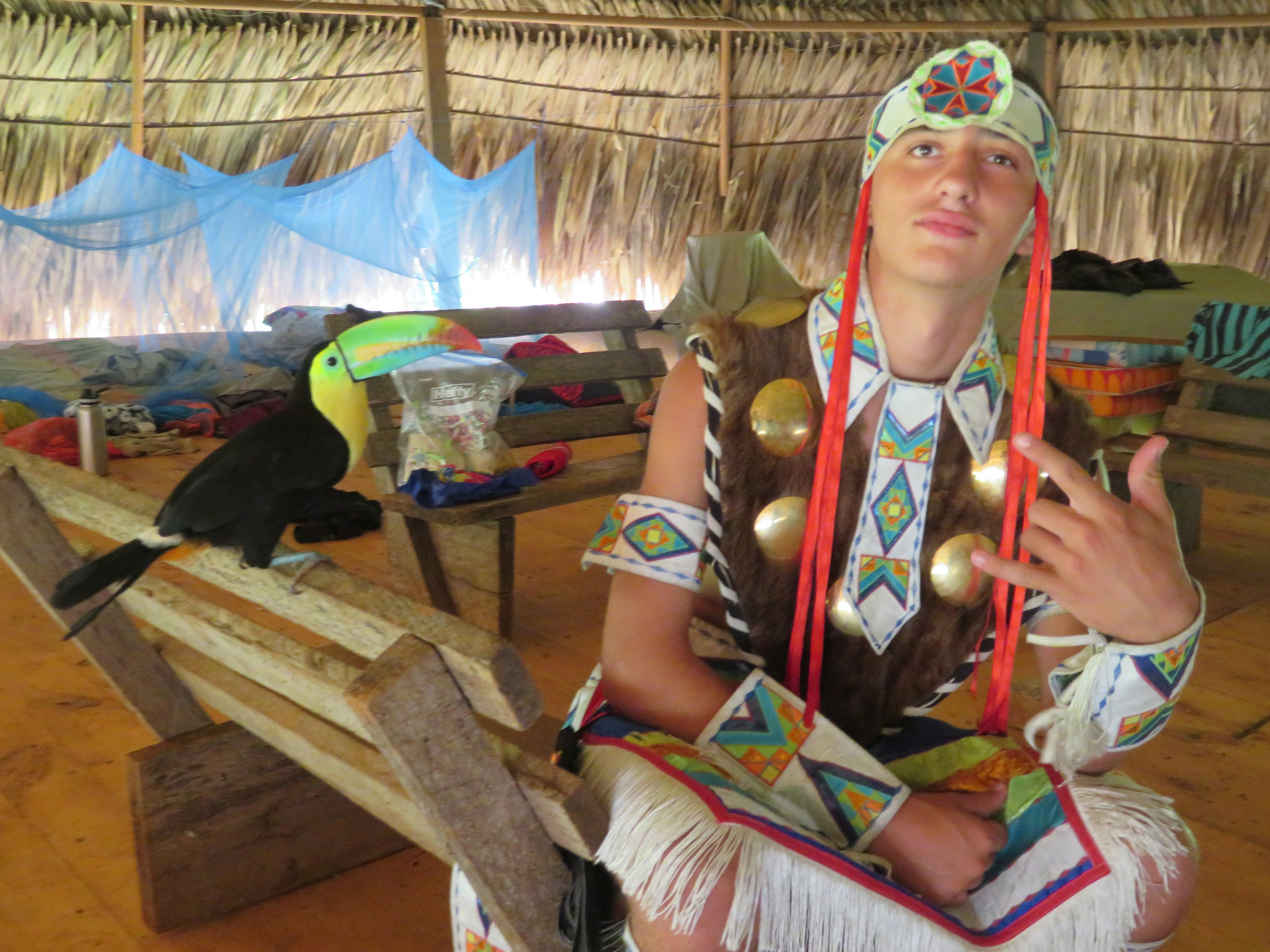 Hawk with his buddy Tony the Tucan in Embera Quera community of Panama, Central America