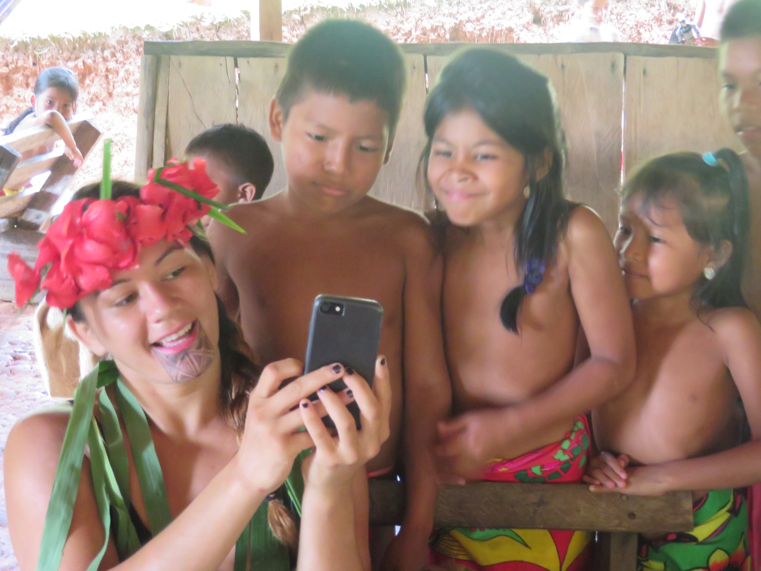 Ilima-lei sharing Aloha with youth of Embera Quera Tribe in Panama. Many indigenous youth have limited access to the world. IT is extra special when aloha comes and is shared.