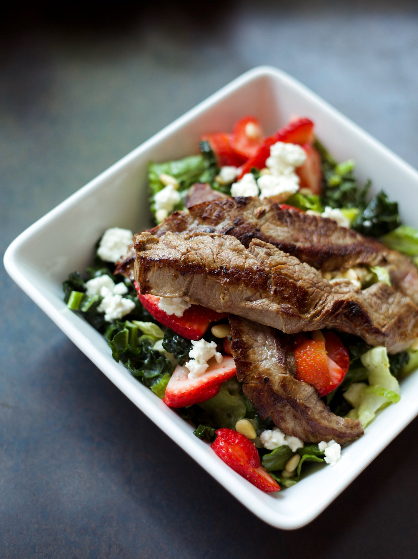 Try out our flank steak salad at any one of our four locations!