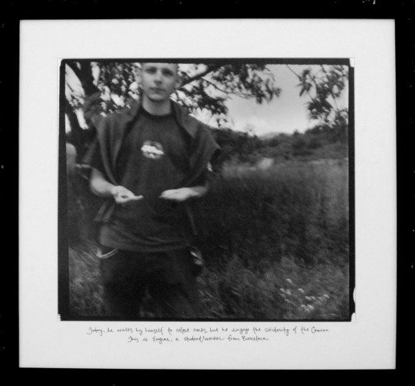 "Eugene  (2005)   Today, he walks by himself to collect rocks, but he enjoys the solidarity of the Camino. This is Eugene, a student/worker from Barcelona.   Silver Gelatin Print, 18""x 18"""