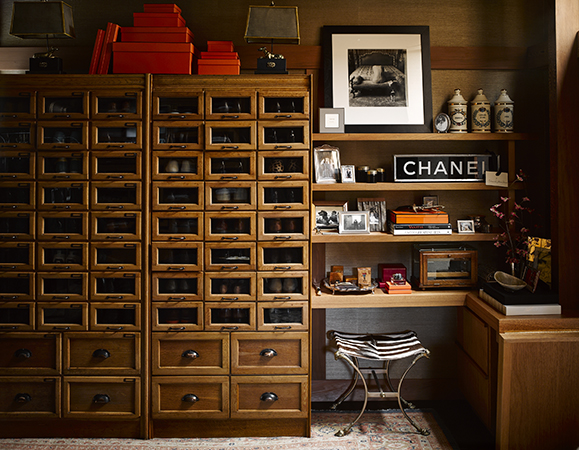 A vintage retail display houses Fulk's shoes at his home in San Francisco.