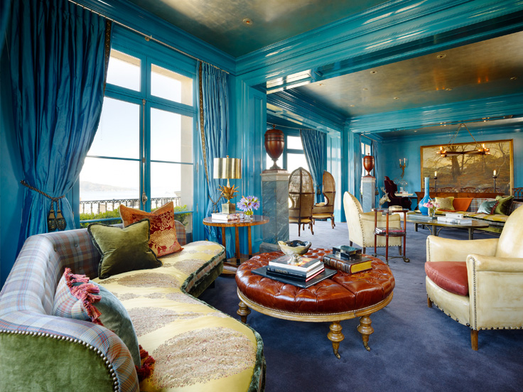 Layers of patterns are surprisingly in harmony with the bold blue lacquered walls.