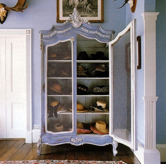 Blue freshens-up this antique armoire.  {via  Haute Design }