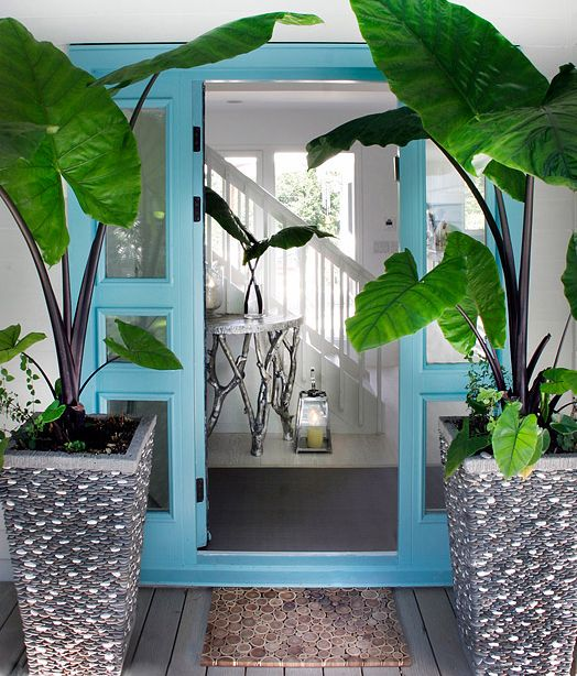 How could you not feel happy walking through this blue threshold? {via  House of Turquoise }