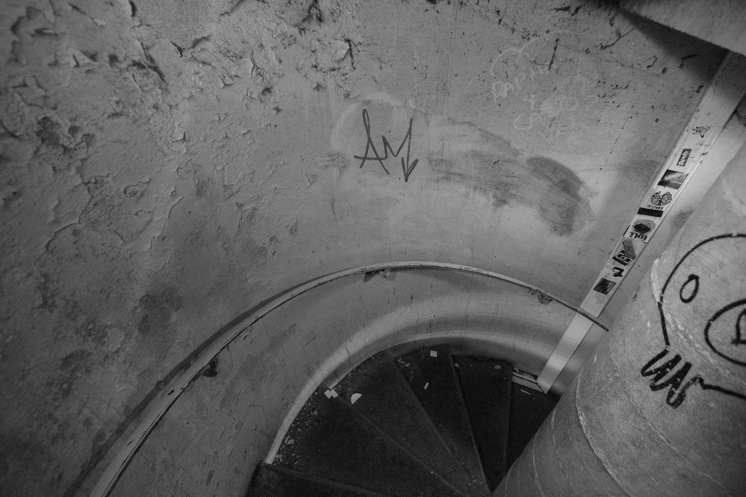 """Staircase to the Paris Underground, """" l'empire de la Mort """" ( the empire of death )."""