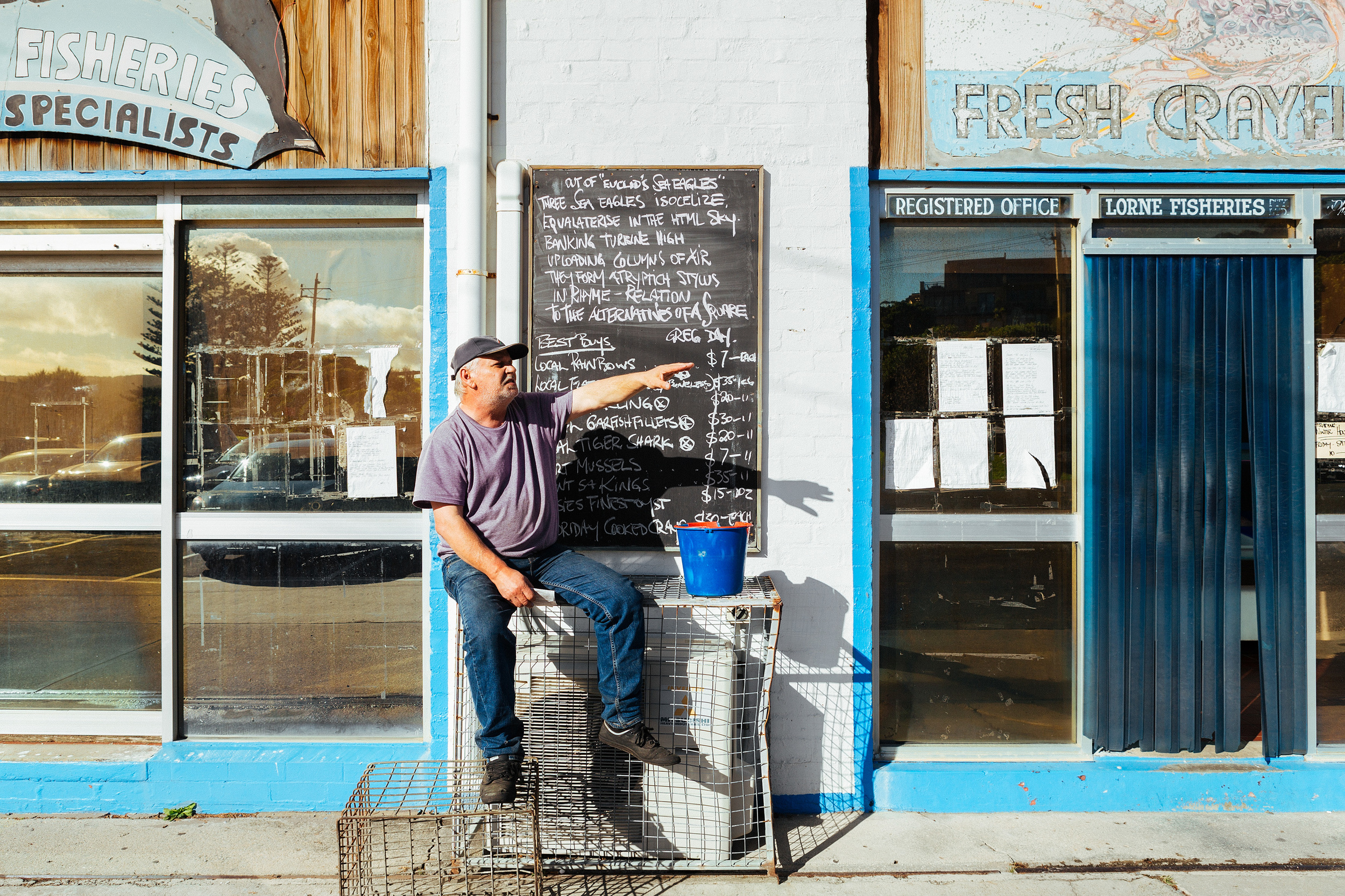 Christos Raskatos is a bit of a local legend.  He has worked at the fishing Co-op since the day dot and he is also the local poet.  Almost daily he scrawls another poem on the chalk board out the front of the shop.