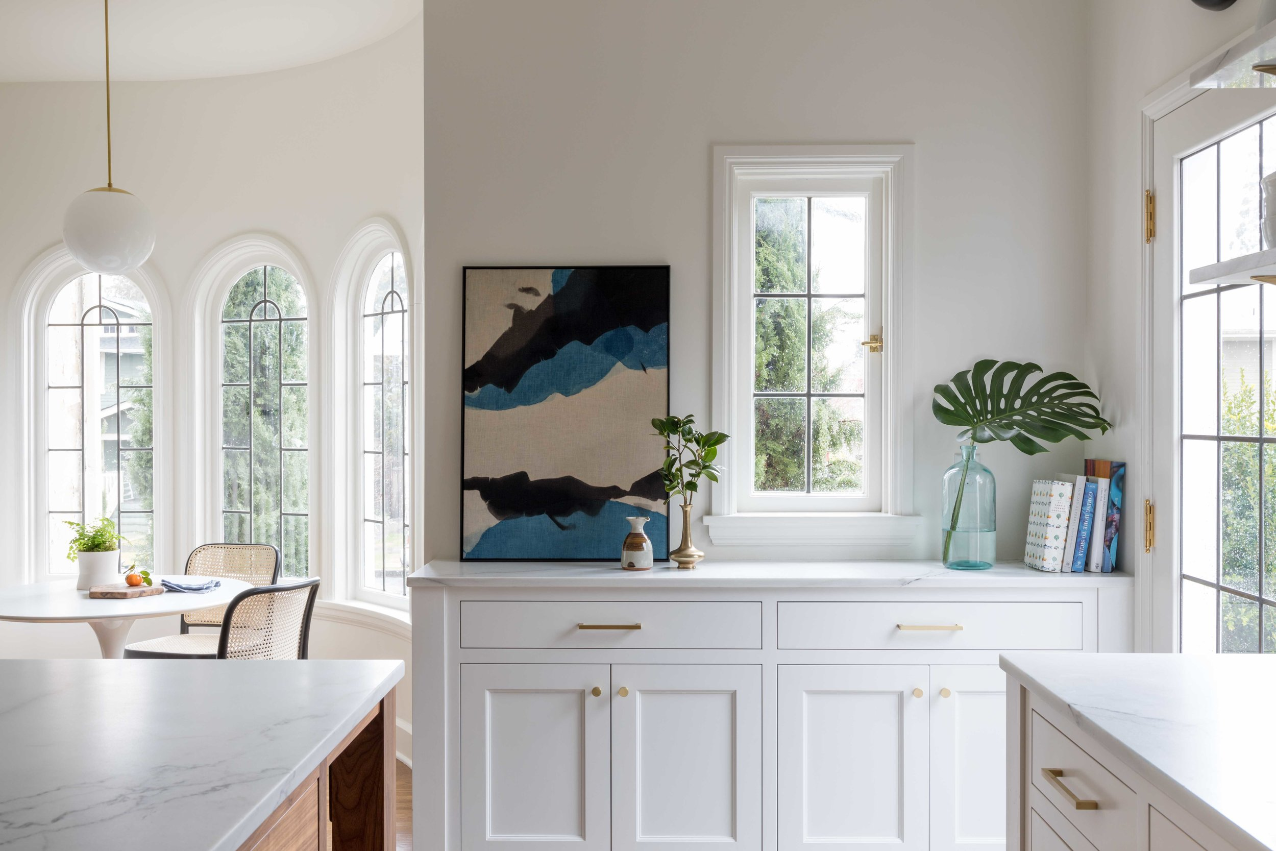 Open Bright Kitchen with Custom Island, Living Space & Brass Details | Casework Interior Design | Portland, OR