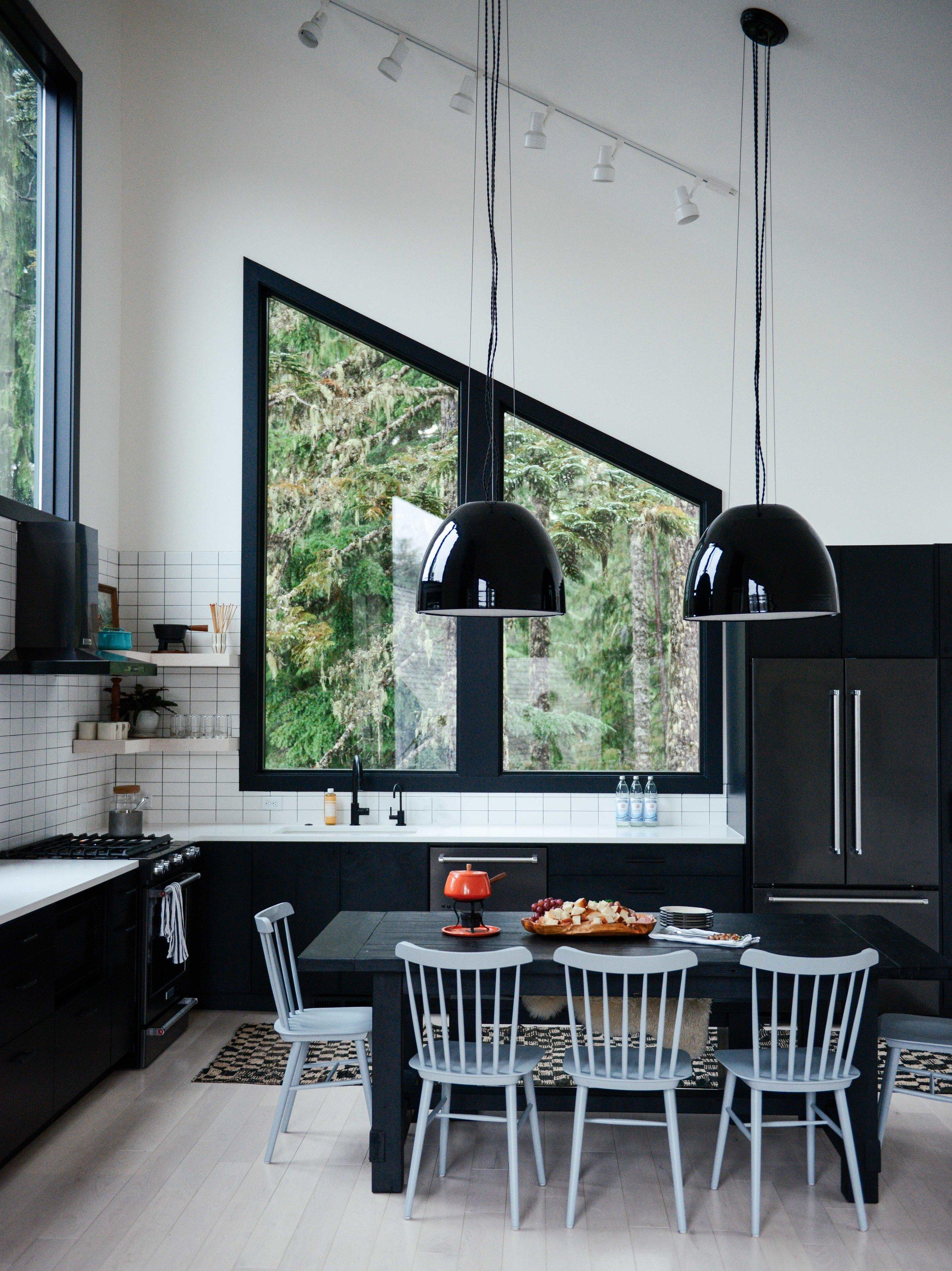 Modern Black & White Mountain Cabin Kitchen with Schoolhouse Pendants | Casework Interior Design | Portland, OR