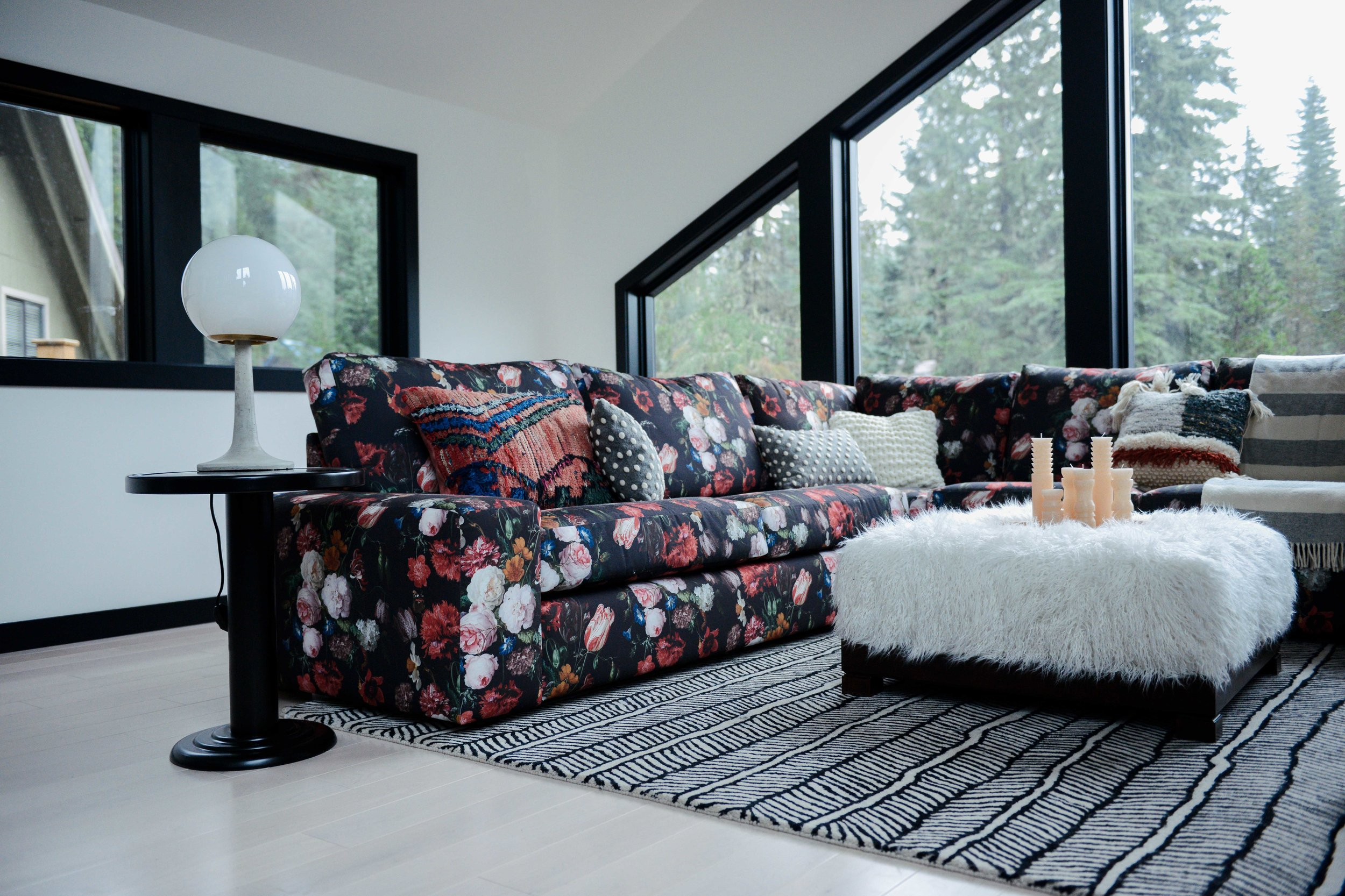 Modern Black & White Mountain Cabin Living Area with Custom Floral Sofa | Casework Interior Design | Portland, OR