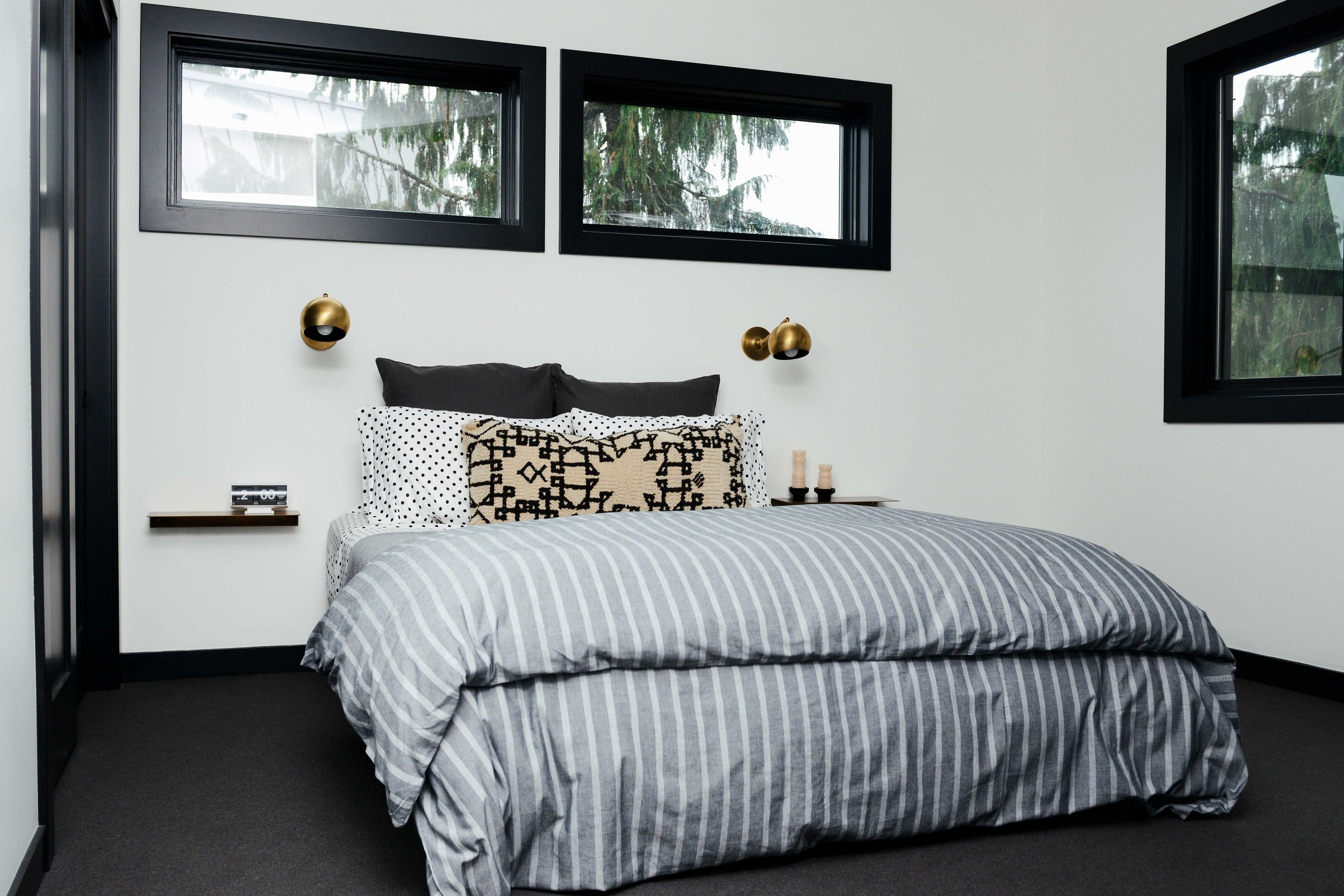 Modern Black & White Mountain Cabin Master Bedroom with Brass Schoolhouse Sconces | Casework Interior Design | Portland, OR