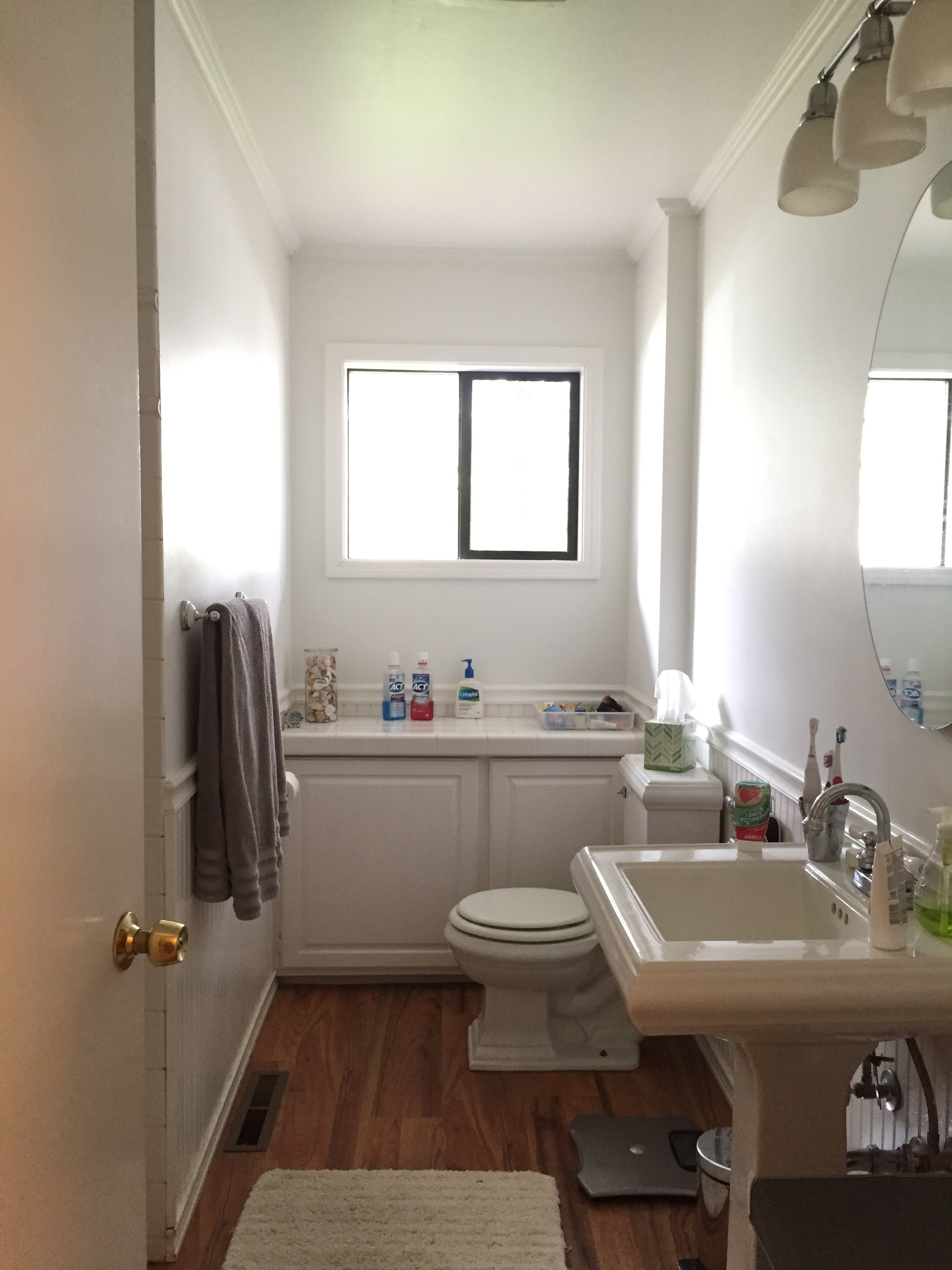 - We bumped out the wall to add a bathtub beneath the window (the current is behind the door), added a double sink vanity and adjusted the window to center on the tub. There were so many rounds of remodeling on this home, from crown molding to a 2000s remodel. It felt good to bring the home back to its original mid century charm with modern updates.