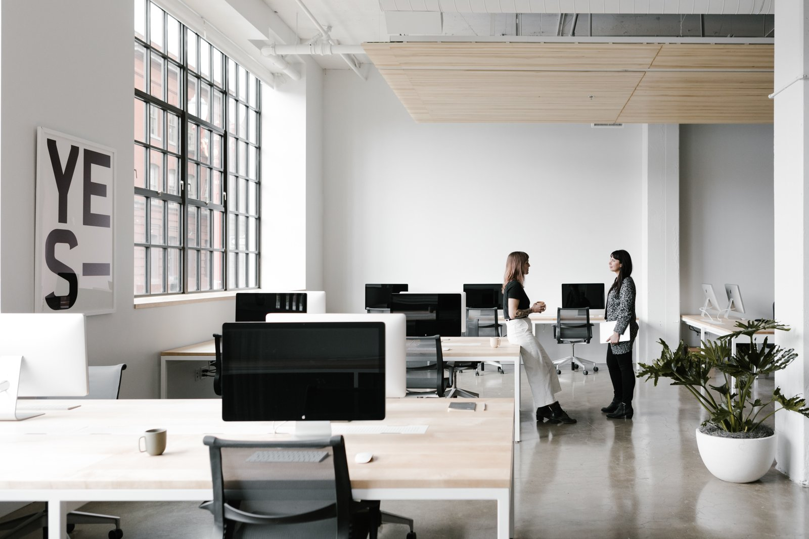 the-office-spaces-are-set-up-for-flexibility-custom-made-desks-include-hidden-troughs-for-wire-management-and-accessibility.jpg