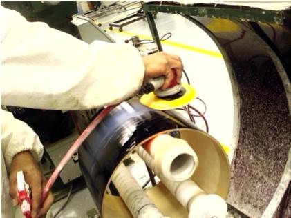 Music Industry: wet sanding finish-coat on drum.