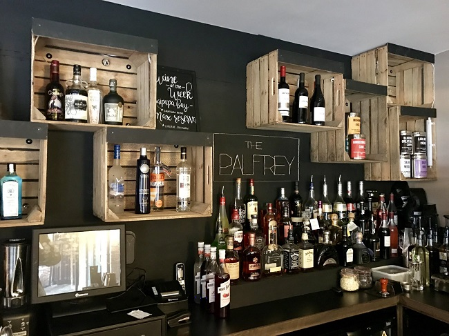 Upcycling these wooden crates makes a perfect display of what The Palfrey has to offer to quench your thirst.