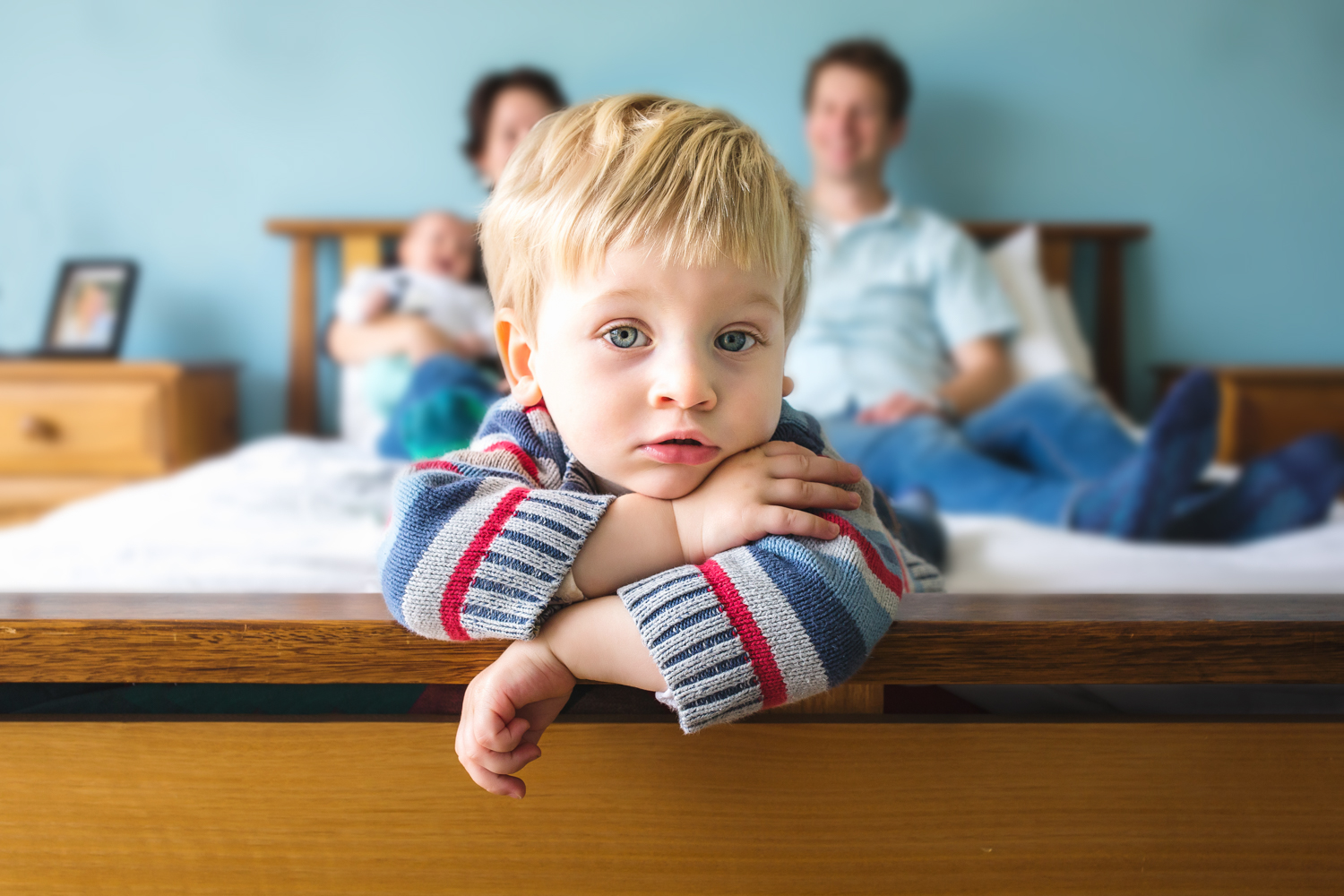 Melbourne family photography photo of toddler on his parents' bed.