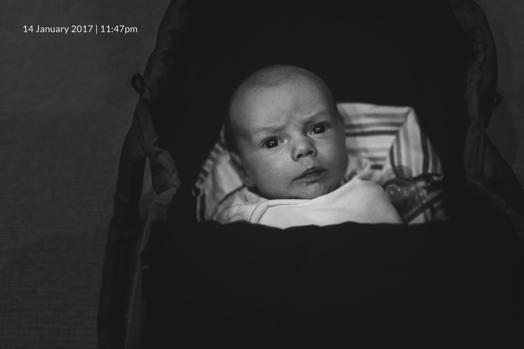 Newborn lifestyle photographer in Melbourne. Black and white lifestyle portrait of a newborn baby.