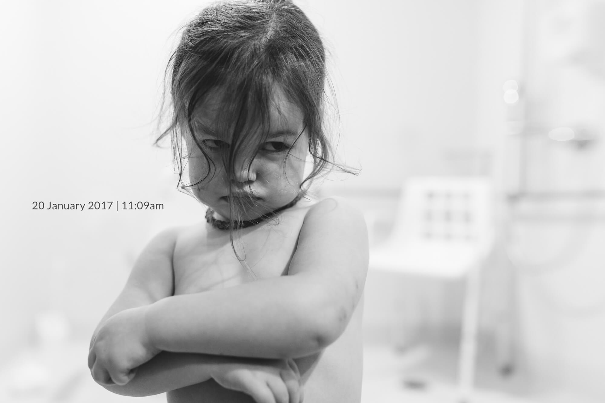 Melbourne child photographer. Black and white portrait of toddler looking sad.