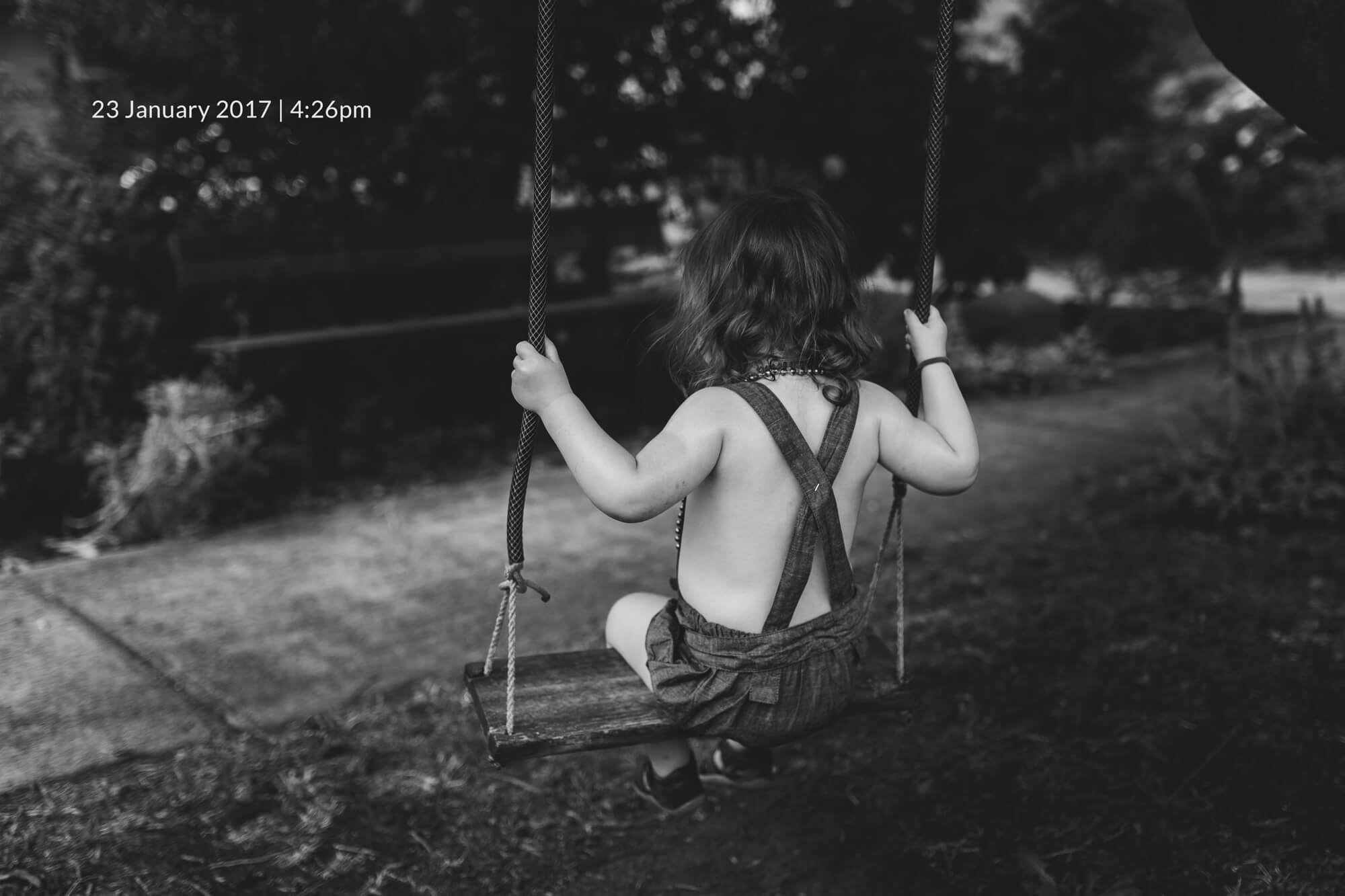 Melbourne family lifestyle photography. Portrait of a toddler on a swing.