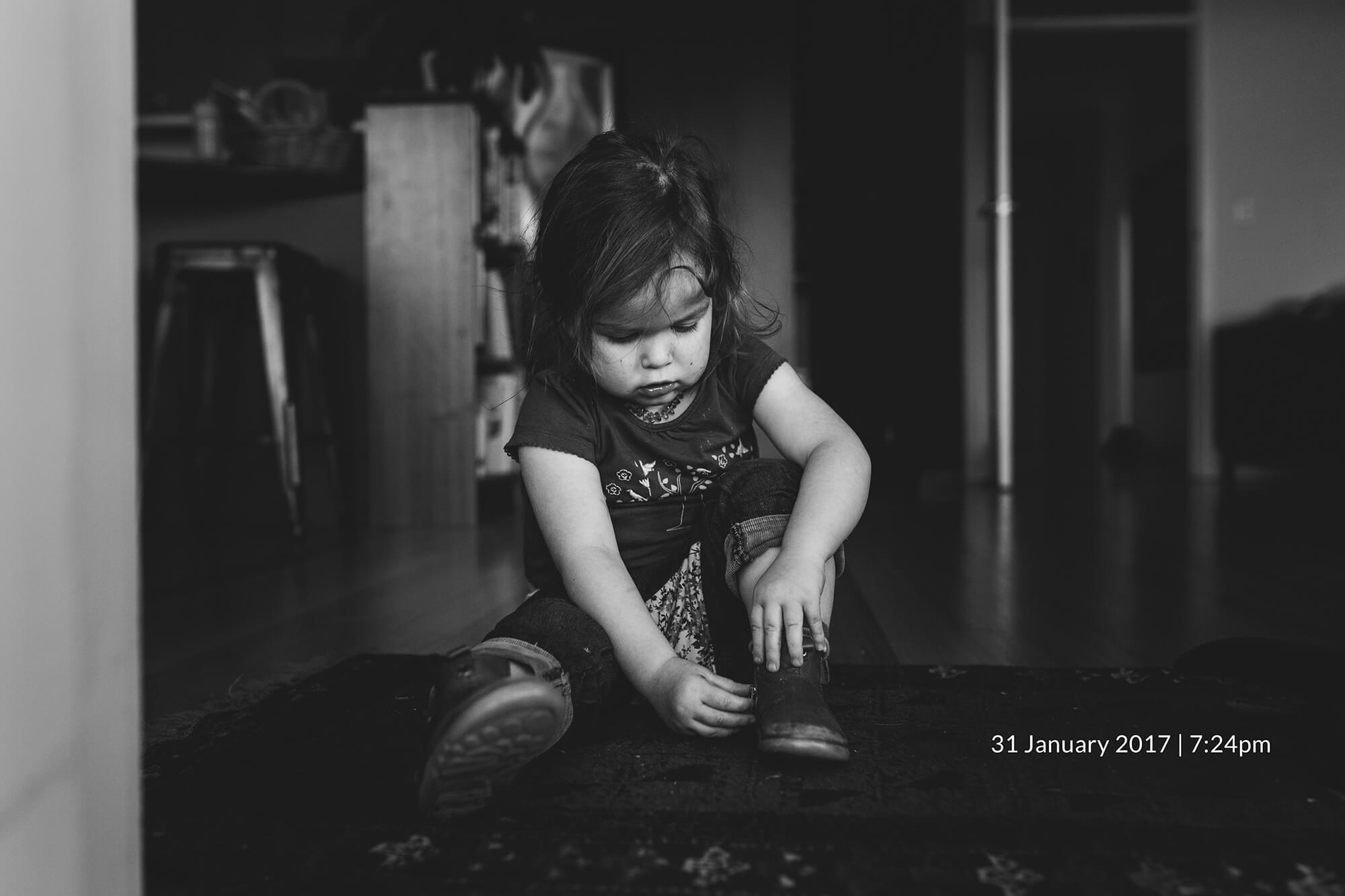Melbourne family photography. Black and white lifestyle photo of a toddler.