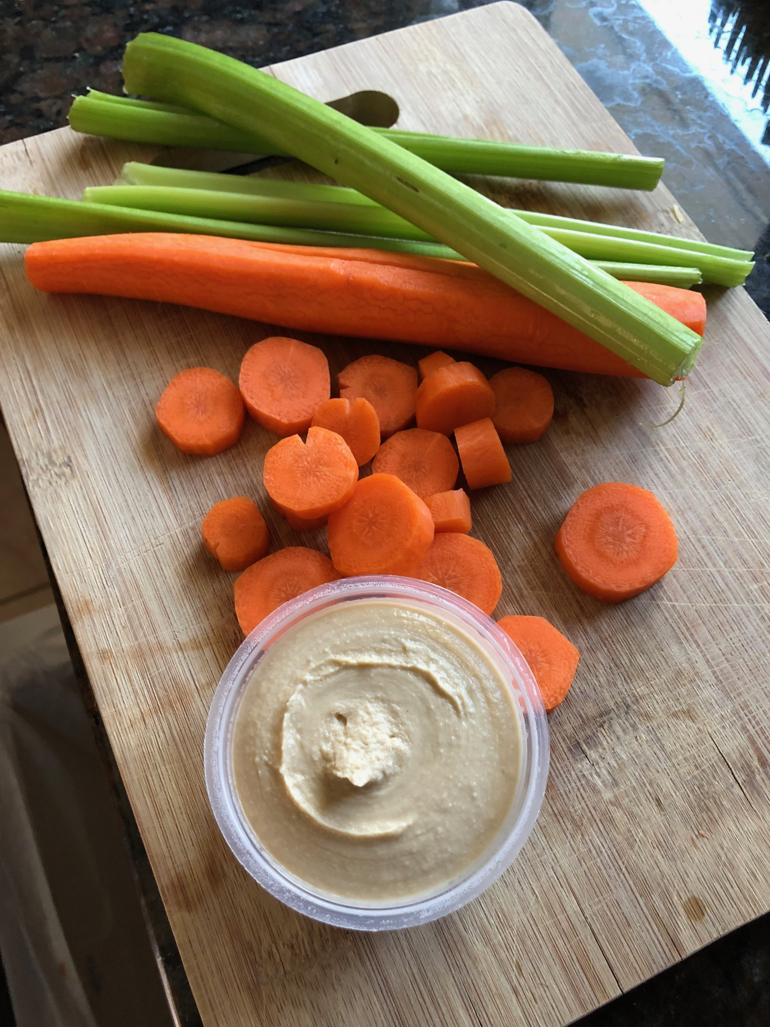 Carrots and hummus can be a tooth-healthy snack.