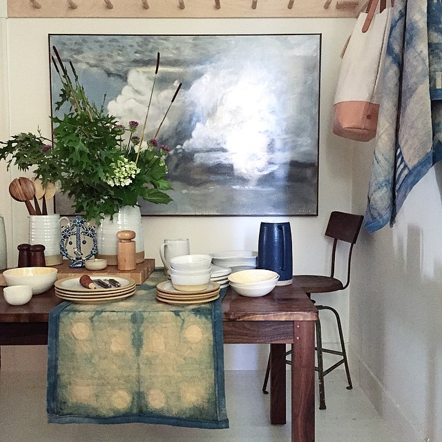 Table Runner (on table) -  Fennel over-dyed with Indigo on Linen Table Runner (hung on right) -  Fennel over-dyed with Indigo on Linen Tote (hung on right) - Canvas and Leather Styled at    The Perish Trust