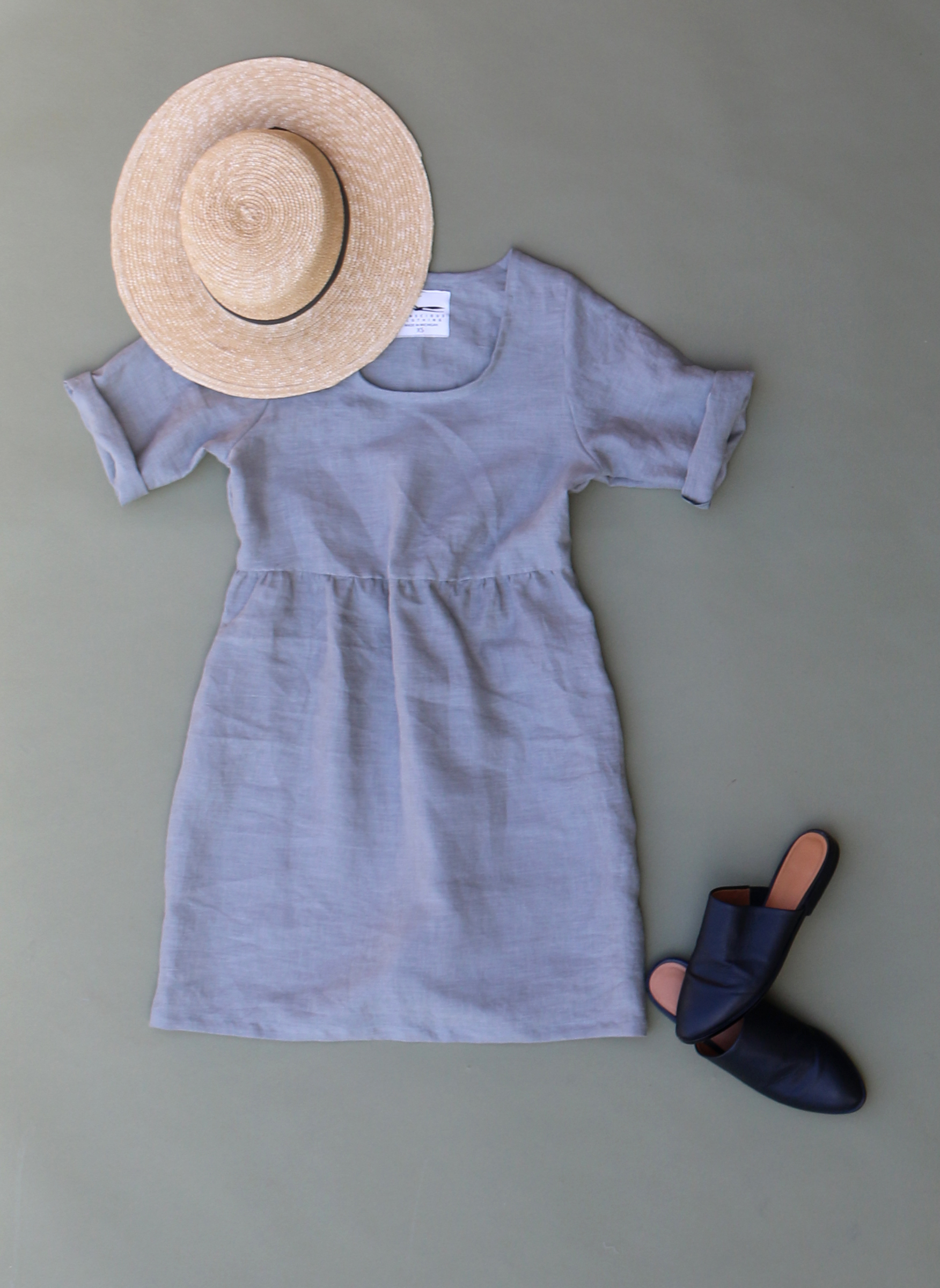 Backyard Tunic in Sage, styled with mules and a sunhat