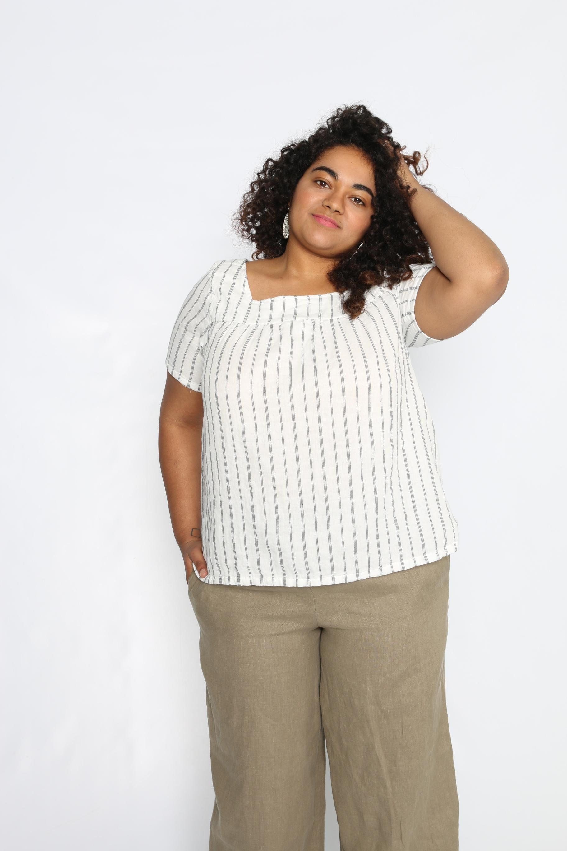 Faith is size Large wearing White Stripe Gauze.