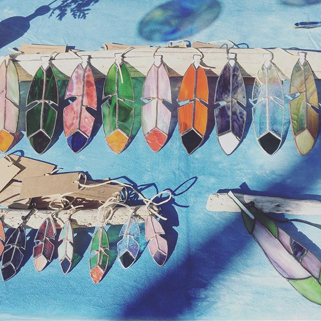 It's a beautiful morning at the farmer's market. Feathers by @thewildernessworkshop. Come by and say hi!