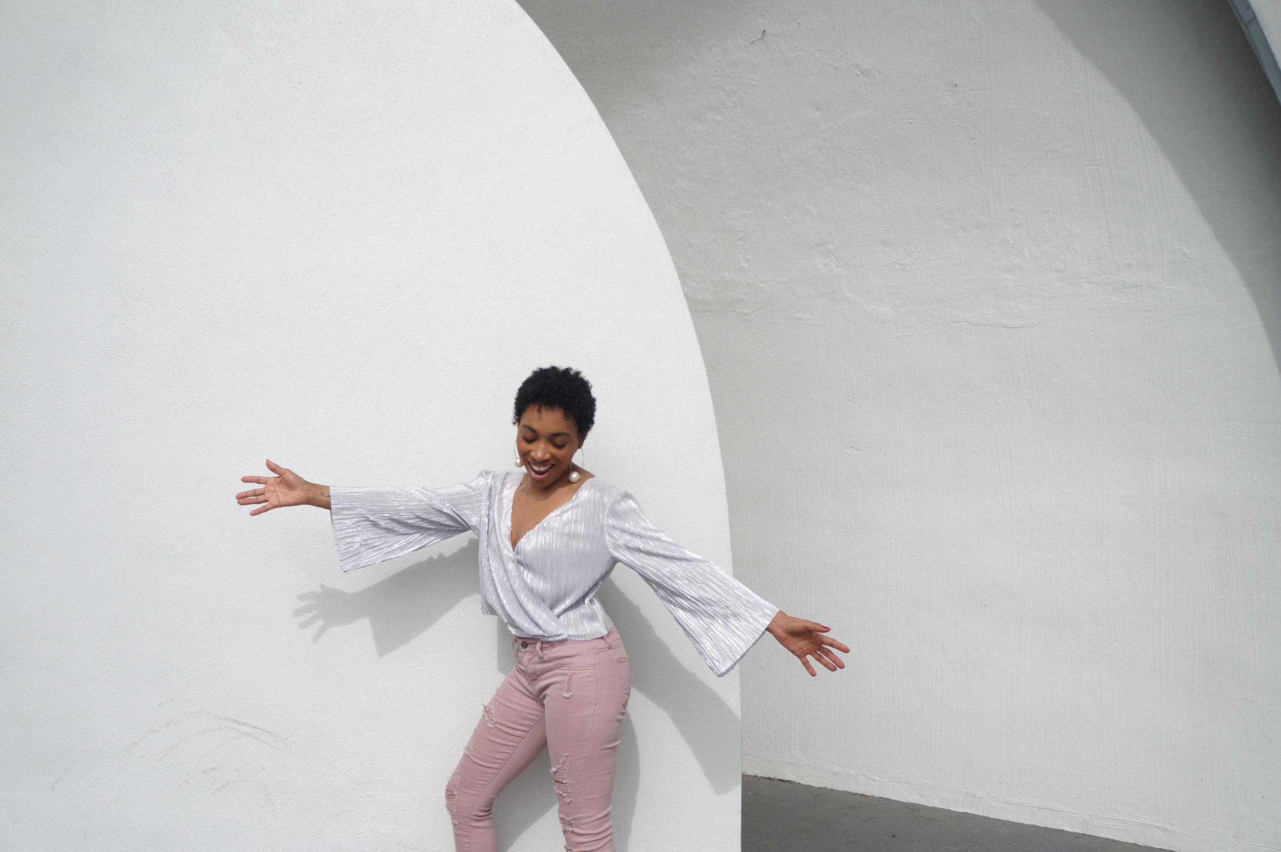 Andrea Fenise Memphis Fashion Blogger styles a metallic blouse