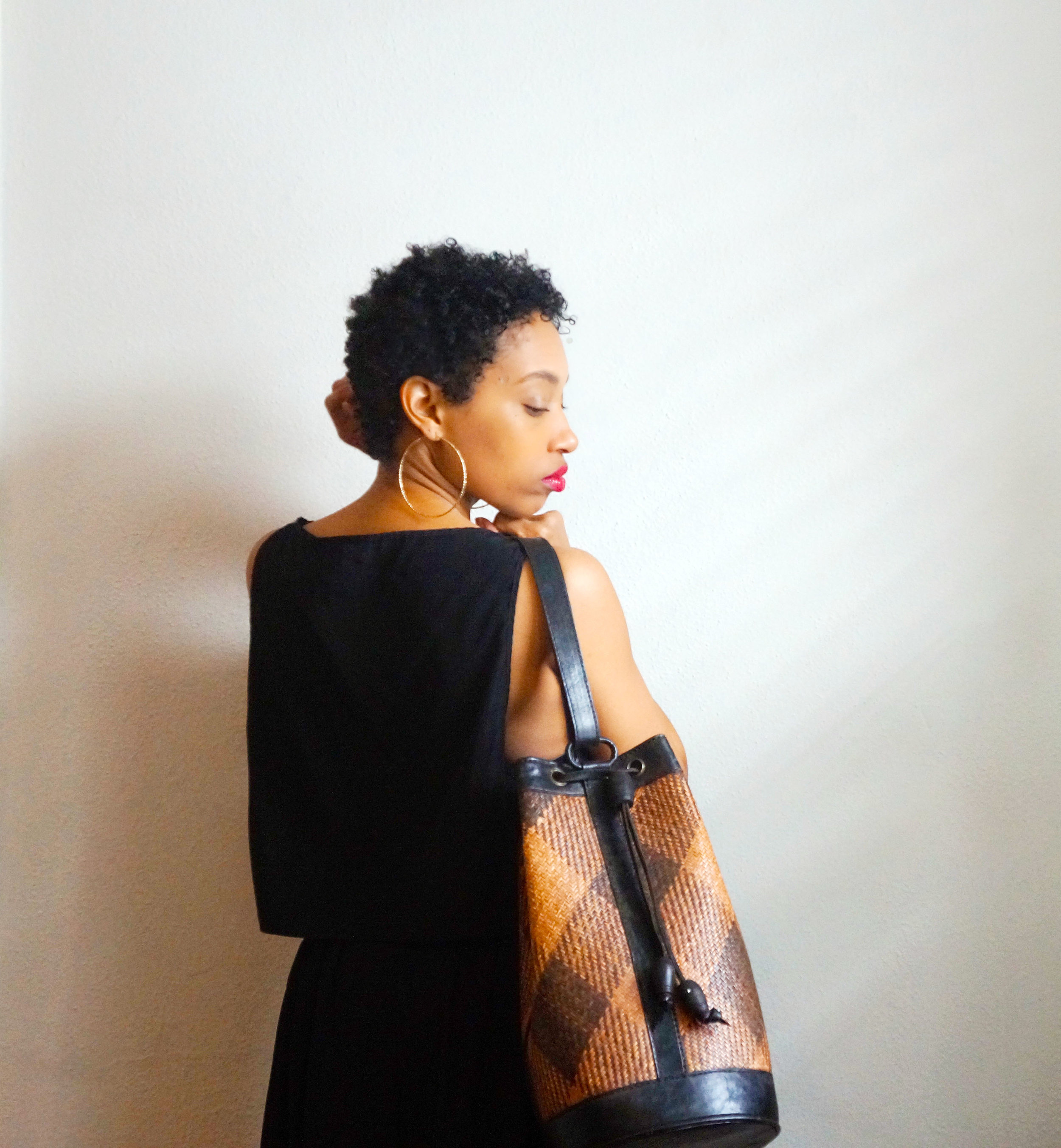 Andrea Fenise Memphis Fashion Blogger styles an African Vintage Bucket Bag