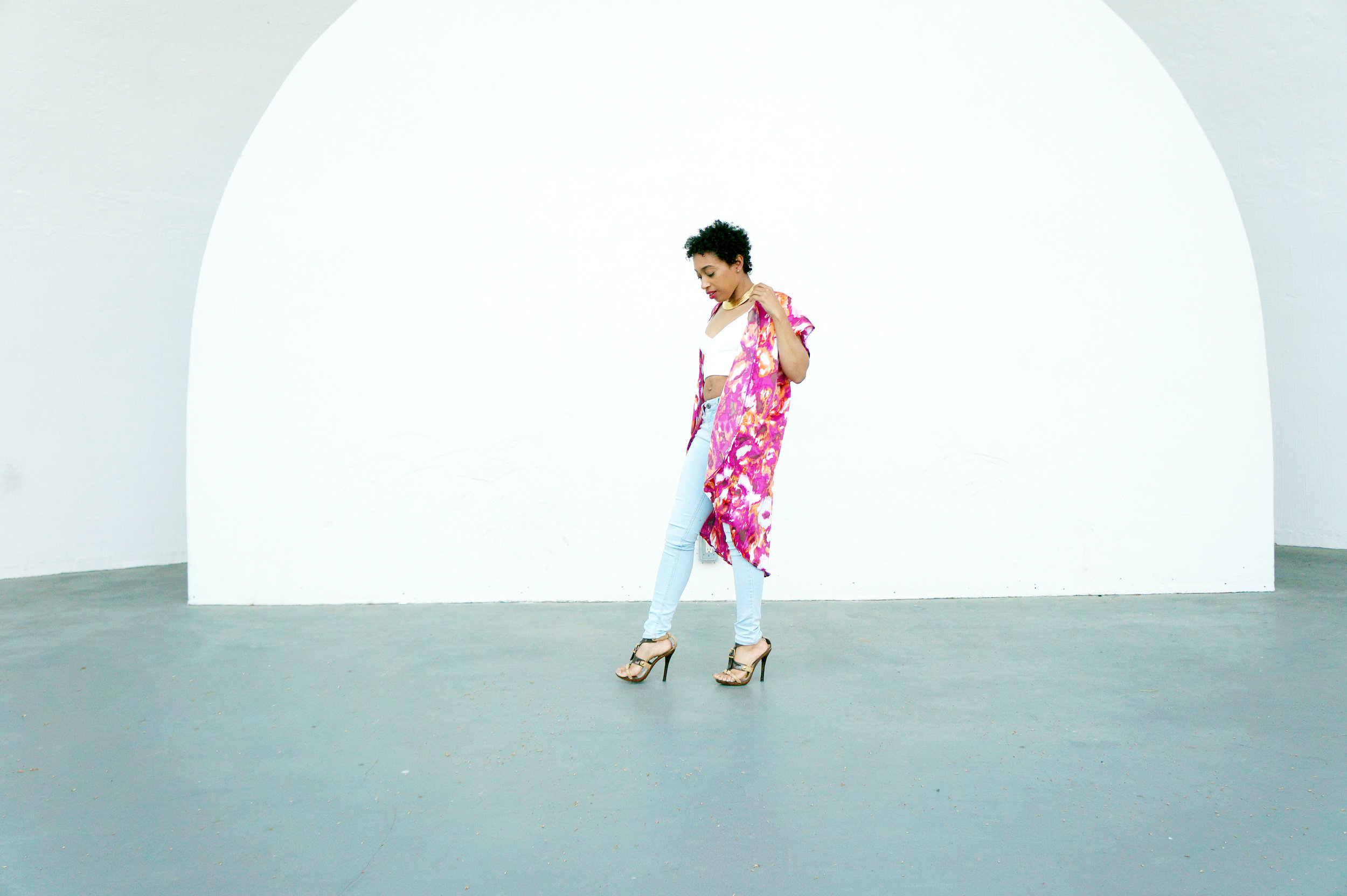 Andrea Fenise Memphis Fashion Blogger styles a kimono and denim look with a crop top