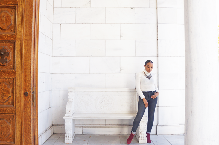 Andrea Fenise Memphis Fashion Blogger styles a white turtleneck and statement necklace