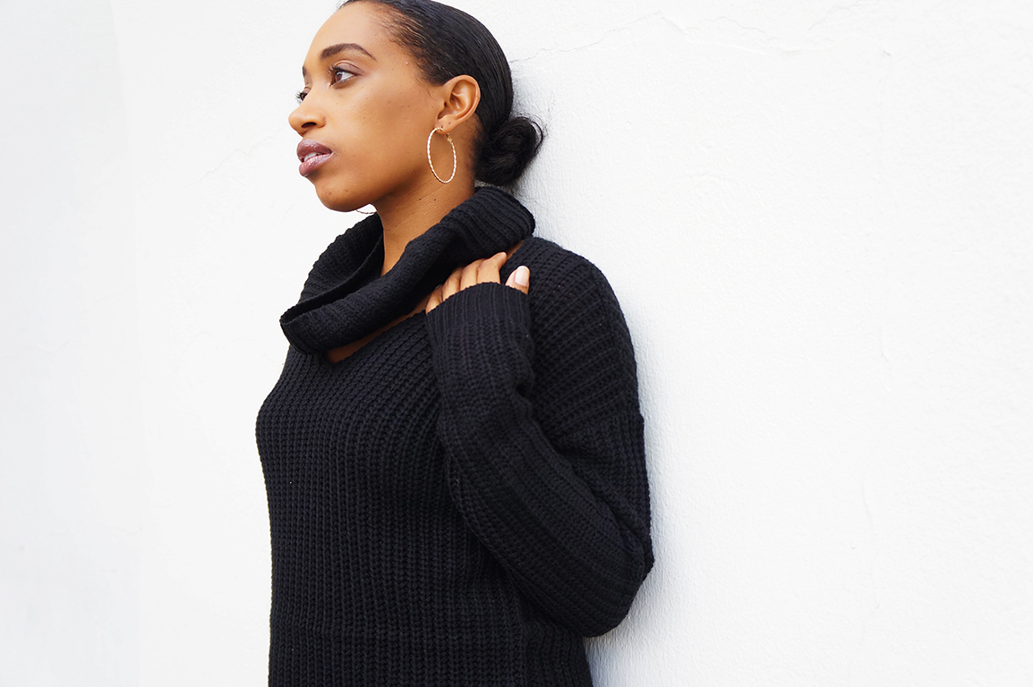 Andrea Fenise Memphis Fashion Blogger styles a cable knit sweater