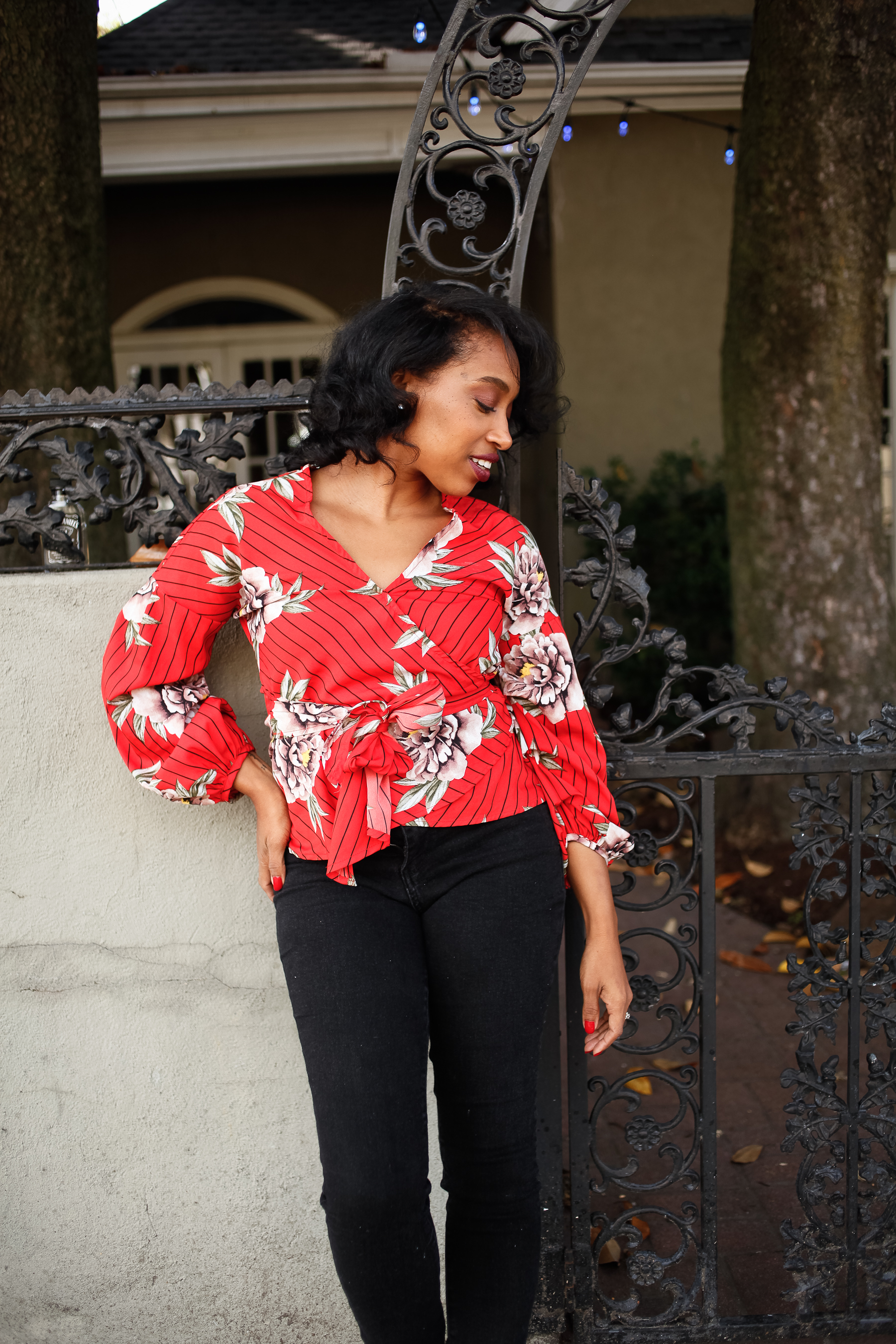 Andrea Fenise Memphis Fashion Blogger shares outfit post on red blouse and black denim